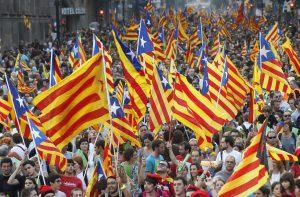 Marchers wave Catalonian nationalist flags as they demonstrate during Catalan National Day in Barcelona