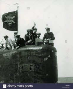 The conning tower of HMS Conqueror with the captain and crew members flying the jolly roger flag of crossed torpedoes and skull returned to Faslane in Holy Loch after sinking Argentinean battleship General Belgrano South Atlantic Falklands War.  July 1982